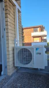 Daikin multi system outdoor unit installed on the wall brackets.